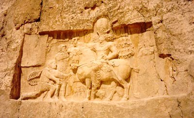 A bas relief of Emperor Valerian standing at the background and held captive by Shapur I found at Naghsh-e Rostam, Shiraz, Iran. The kneeling man is probably Philip the Arab.